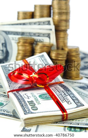 close-up of coins and american dollars with red ribbon isolated on white