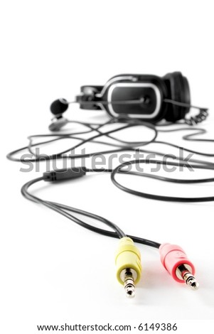Close-up of color connectors and headset at disfocused far plane - stock photo