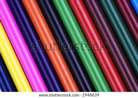 Close up of color pencil lined up in a row. - stock photo