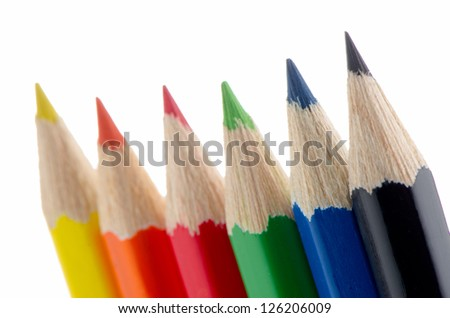 Close up of color pencils with different color over white background