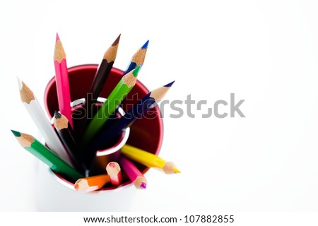Close up of color pencils with different color over white background. Macro with extremely shallow depth of field - stock photo