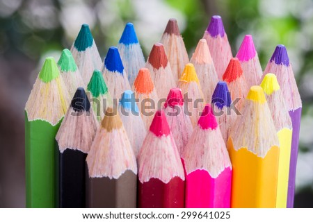 Close up of colored drawing pencils on bokeh background - stock photo