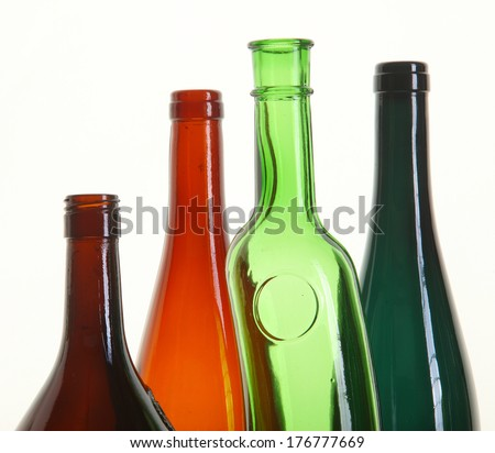 close-up of colored glass bottle necks isolated on white background studio - stock photo