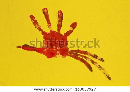 Close up of colored hand print on yellow background - stock photo