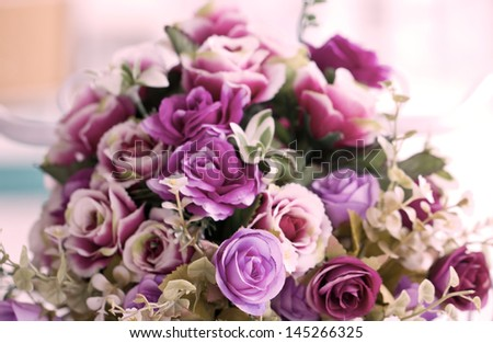 Close up of colorful artificial flowers. - stock photo