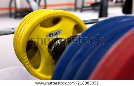 close-up of colorful barbell in gymnasium - stock photo