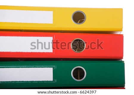 Close up of colorful binders against white background. Office life. - stock photo