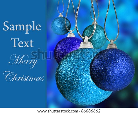 Close up of colorful blue christmas baulble balls in different sizes  hanging on strings - stock photo