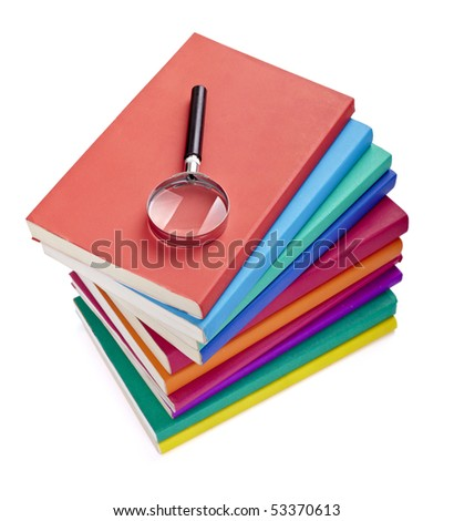 close up of colorful books  and magnifying glass on white background with clipping path - stock photo
