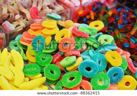 close up of colorful candies on market stand - stock photo