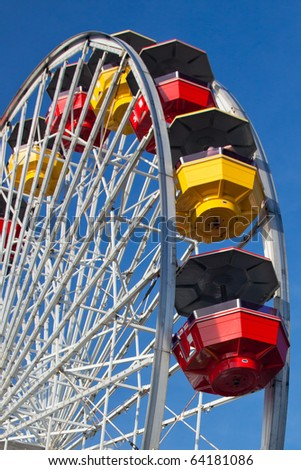 Close-up of Colorful Ferris Wheel on Vivid Blue California Sky Background