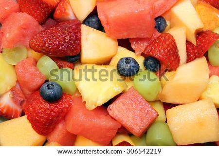 Close up of colorful fruit salad - background - stock photo