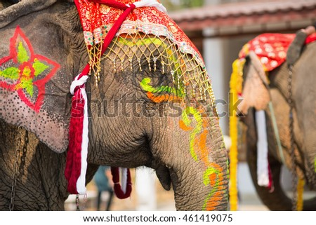Close up of colorful painted elephant head at annual celebration event in Sukhothai, Thailand.