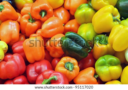 close up of colorful peppers on market stand - stock photo