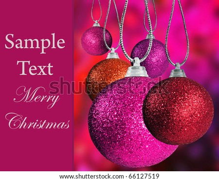 Close up of colorful pink christmas bauble balls in different sizes  hanging on strings - stock photo