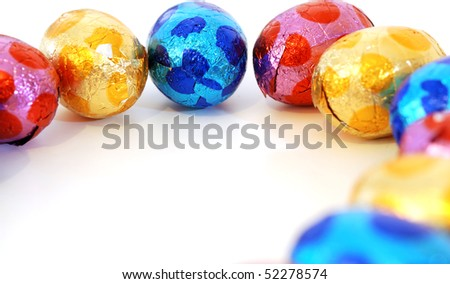 close-up of colorful small eggs against white background for your easter design