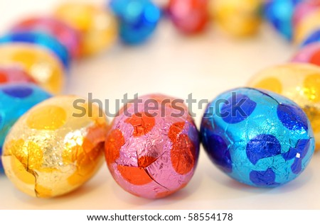 close-up of colorful small eggs against white background for your easter design - stock photo
