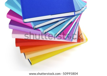 Close-up of colorful spiral book stairs on white background, top view. - stock photo