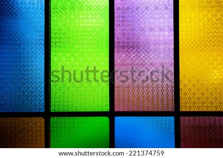 Close up of colorful stained glass - stock photo