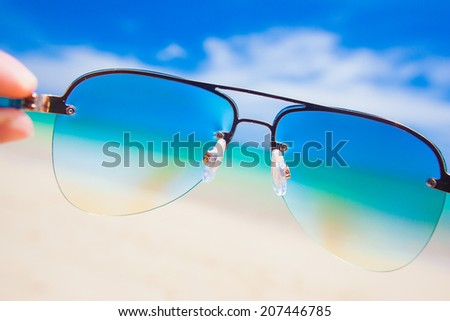 close up of colorful sunglasses. tropical Thailand beach. travel concept