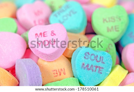 close up of colorful valentine candy hearts - stock photo
