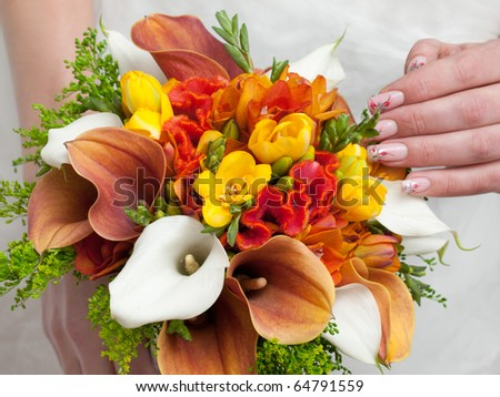 close-up of colorful wedding bouquet at bride's hands - stock photo