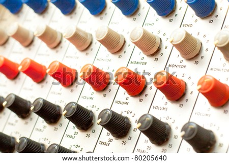 Close up of colourful amplifier dials - stock photo