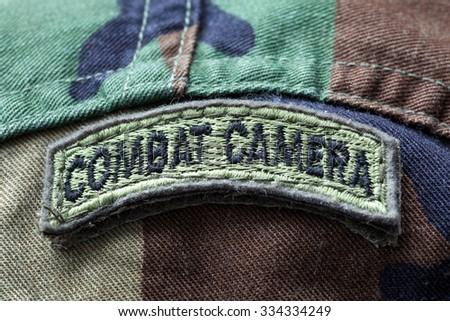 Close-up of Combat Camera army patch on a camo uniform - stock photo