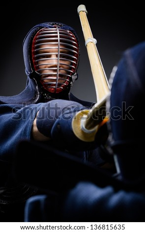 Close up of competition of two kendo fighters. Japanese martial art of sword fighting - stock photo