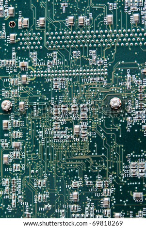Close up of computer circuit board in green - stock photo