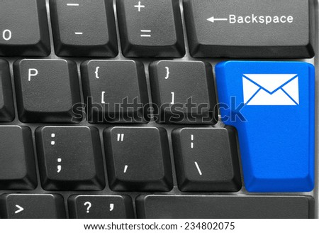 Close-up of Computer keyboard,  with blue Mail key - stock photo