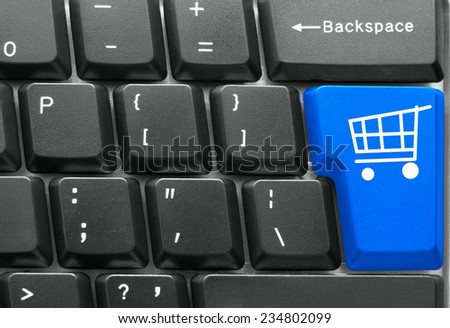 Close-up of Computer keyboard,  with blue Shopping key - stock photo