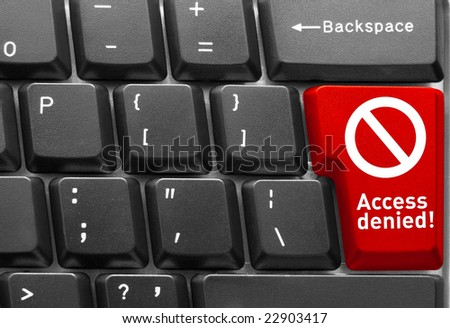 """Close-up of Computer keyboard, with red key of """"Access denied"""" - stock photo"""