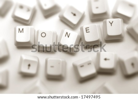 Close up of computer keys with money word