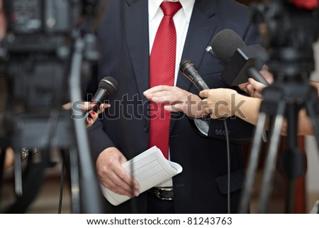 close up of conference meeting microphones and businessman - stock photo