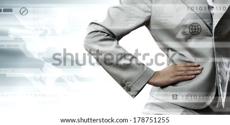 Close up of confident businesswoman with hand on waist - stock photo