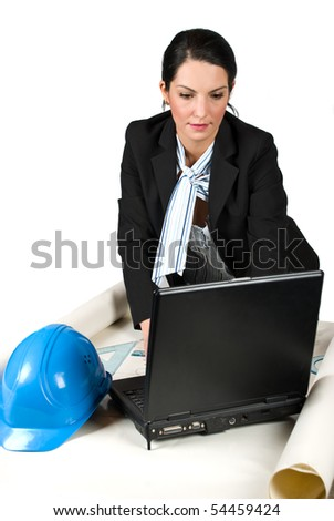Close up of constructor woman engineer working in office on laptop and projects isolated on white background - stock photo