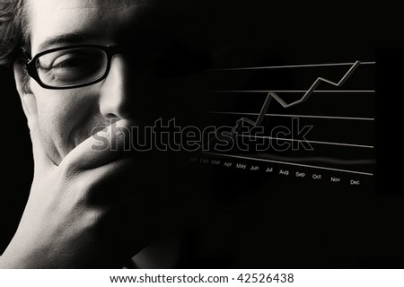 Close-up of content male professional being happy about prosperous business outlook, low- key black & white image. - stock photo