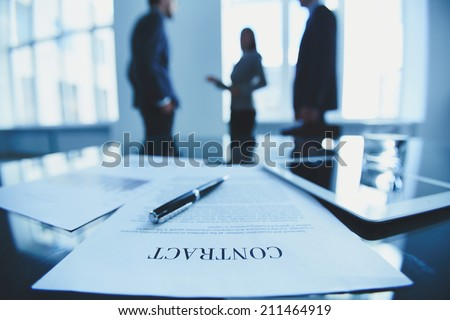 Close-up of contract on office table - stock photo