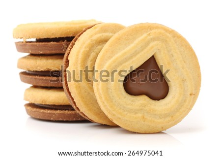 Close up of cookies / biscuits filled with chocolate on white background - stock photo