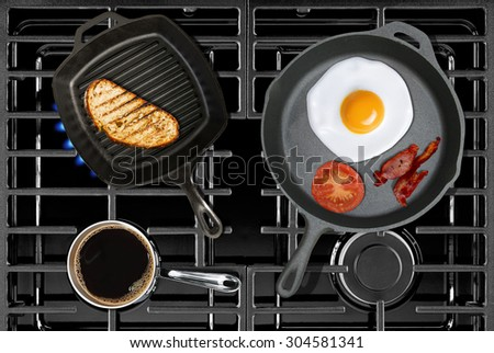 Close-up of cooking continental breakfast on stove top view - stock photo