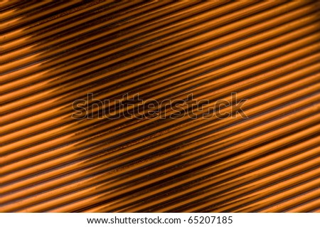 Close-up of copper coil wiring - stock photo