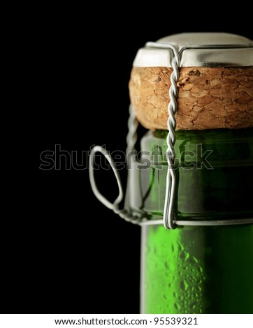 Close-up of cork on a closed bottle of  Champagne - stock photo