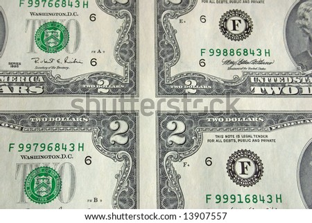 Close up of corners of 4 bills in a sheet of two dollar bills - stock photo