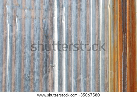 Close up of corrugated metal with rust - stock photo