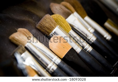 Close up of cosmetic brushes on black background - stock photo