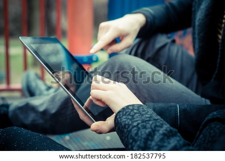 close up of couple hands using tablet - stock photo