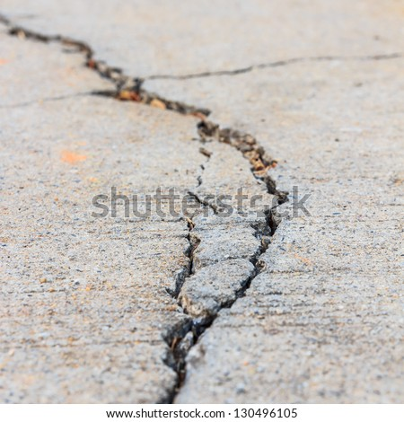close up of crack cement road - stock photo