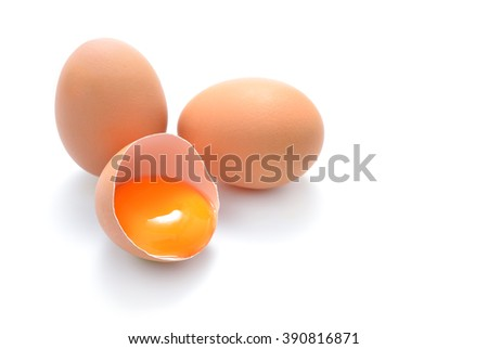 Close up of cracked egg isolated on white background