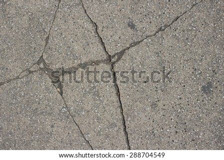 close up of cracked paving slab texture - stock photo